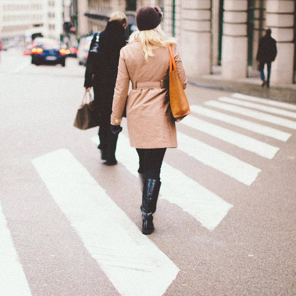 Two women crossing road